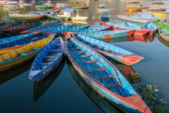 colorful boats on Phewa Tal lake in pokhara